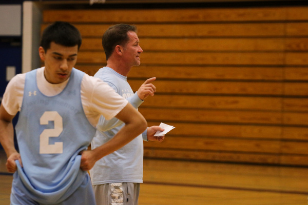 Deer Valley Basketball Coach Jed Dunn, point guard Johnny Diaz at practice